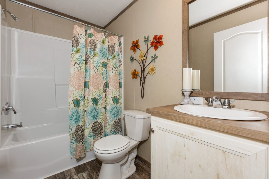 The VSN 8016-1680 VISION I Guest Bathroom. This Manufactured Mobile Home features 3 bedrooms and 2 baths.