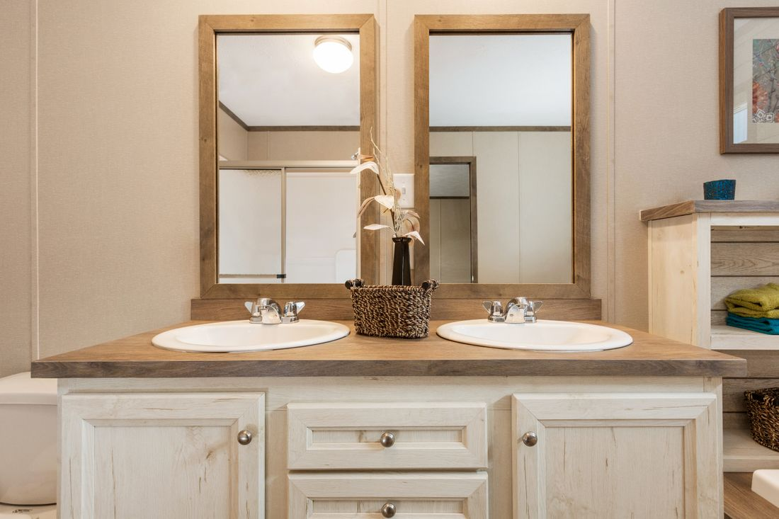 The VSN 8016-1680 VISION I Master Bathroom. This Manufactured Mobile Home features 3 bedrooms and 2 baths.
