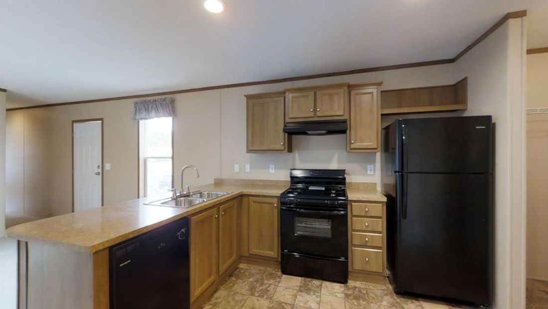 The EMERALD Kitchen. This Manufactured Mobile Home features 2 bedrooms and 2 baths.
