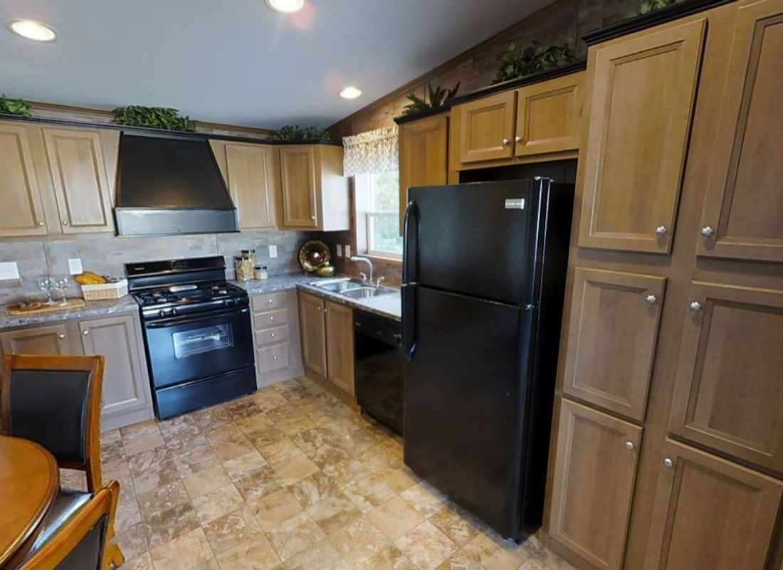 The REDWOOD 3828-38 Kitchen. This Manufactured Mobile Home features 3 bedrooms and 1 bath.